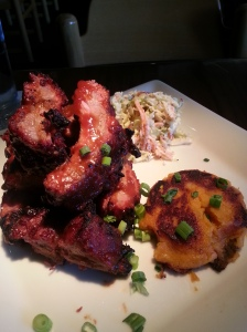 Half-Rack Barbecued BABY-BACK RIBS with coleslaw and cayenne potato yam cake.  21.50